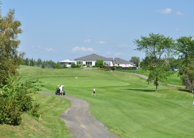Golfing_green_with_cart at Forest Ridge Golf & Country Club in Chelmsford, Greater Sudbury